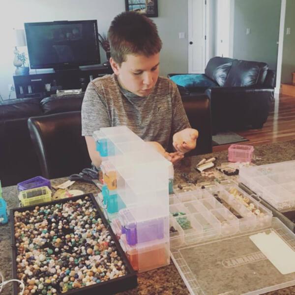 teacher's pet giving back - shake it off design - evan sorting beads