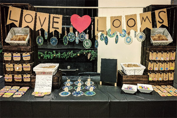 teacher's pet giving back - love heart looms products display booth