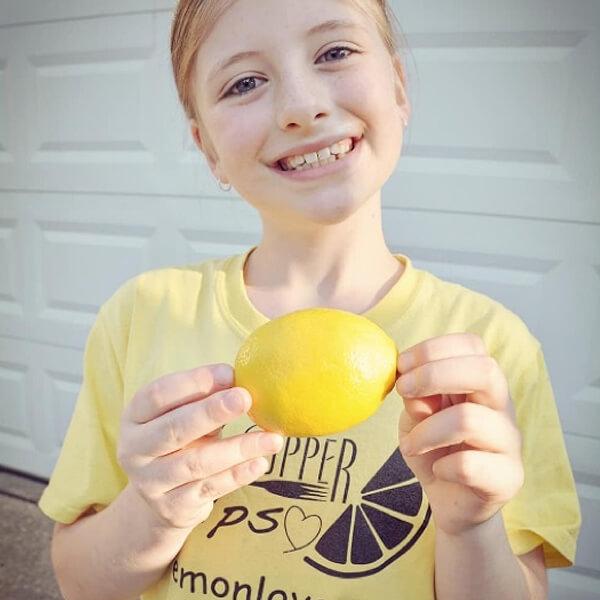 teacher's pet giving back - love heart looms - girl smiling holding a lemon